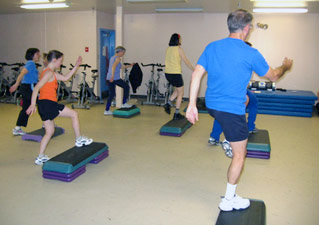 Fitness enthusiasts participate in an aerobic StrongStep class in Jacki Sorensen's Fitness Classes.